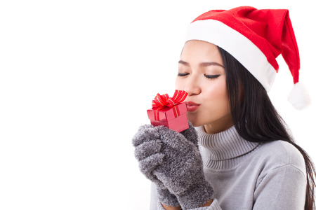 happy woman with red gift box and christmas santa hat photo