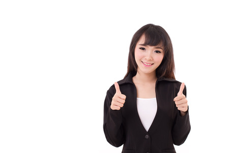 beautiful businesswoman giving, showing two thumbs up photo