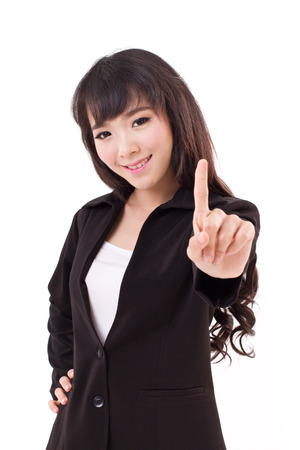 young adult business woman showing one finger, number 1 hand gesture photo