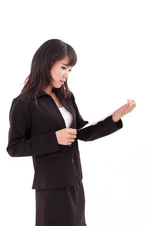 stunned: portrait of stunned, surprised, negative, frustrated asian business woman executive looking at document, isolated white background