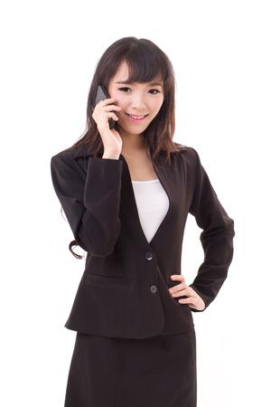 businesswoman using or talking via smartphone, studio isolated photo