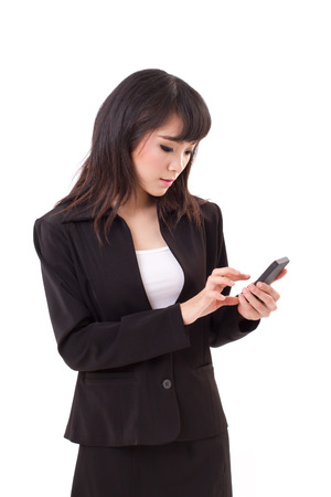 asian female business woman executive texting, messaging, using smartphone application photo