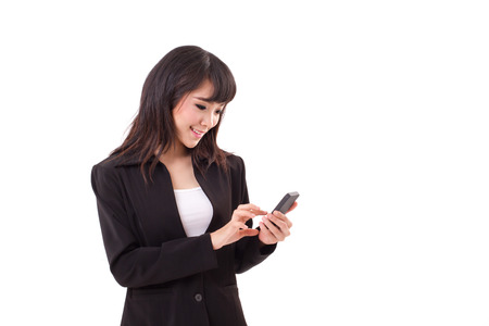 asian female business woman executive texting, messaging, using smartphone application with touchscreen technology photo