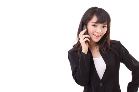 portrait of businesswoman using or talking via smartphone, white isolated photo