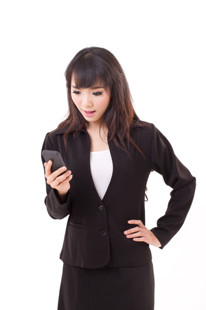 stunned, surprised, exited businesswoman looking at news application message update via smartphone photo