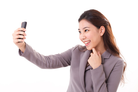 business woman taking selfie photo with her smart phone photo