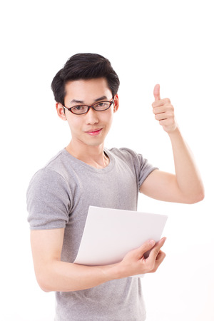 one young man: happy genius smart nerd or geek man giving thumb up hand gesture Stock Photo