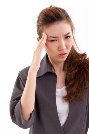 overwork: sick business woman suffers from headache pain, migraine, unstable emotion, overwork Stock Photo