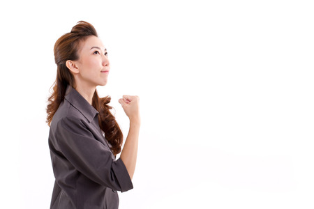 successful business woman looking up, isolated photo