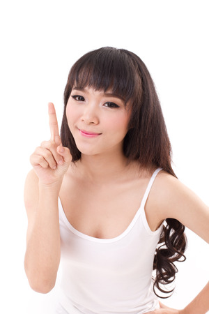 woman pointing up: happy, smiling woman raising, pointing her finger up, white isolated
