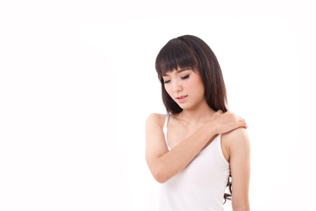 cramped: woman suffers from heavy shoulder pain or stiffness Stock Photo