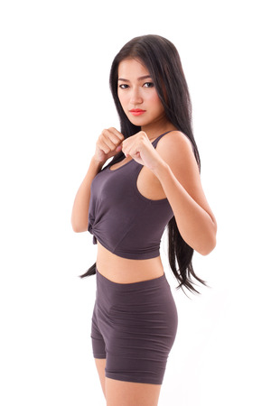 martial arts woman: strong sporty fitness woman practice martial arts, boxing