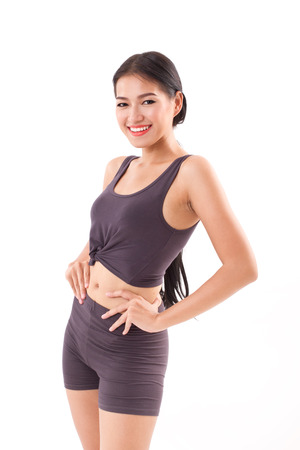 arms akimbo: strong, happy, smiling,  healthy fitness woman posing arms akimbo