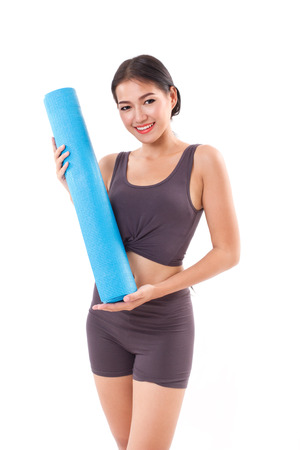 fitness woman with yoga mat photo