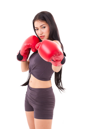 strong fitness woman boxer or fighter punching photo