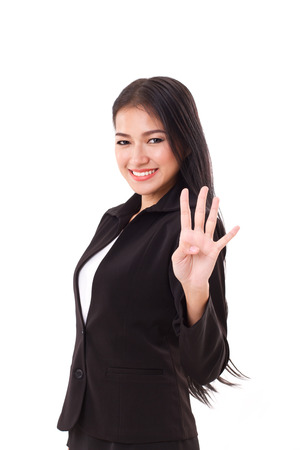 fingers: smiling, confident, successful business woman executive showing, pointing up 4 fingers gesture