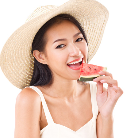 happy woman eating watermelon, summer time concept photo
