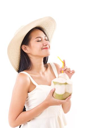 happy summer woman enjoying fresh coconut juice photo