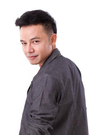 portrait of confident, happy, positive asian man looking over shoulder photo