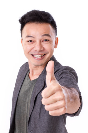 happy, exited man giving thumb up photo