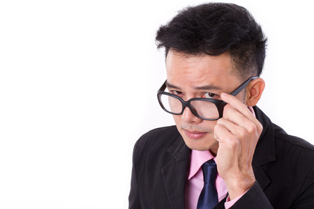 business skeptical: curious businessman looking at you Stock Photo