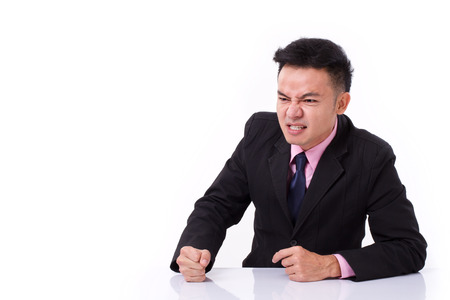 angry businessman: angry businessman looking away