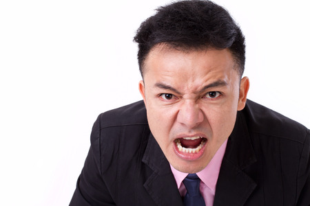 grinding teeth: angry businessman shouting, screaming, looking at you Stock Photo