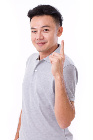 no1: happy, smiling man giving no.1 hand gesture