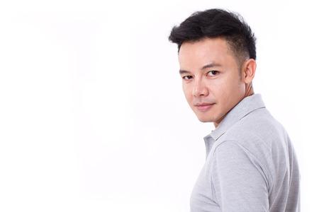looking over shoulder: portrait of asian man looking over his shoulder