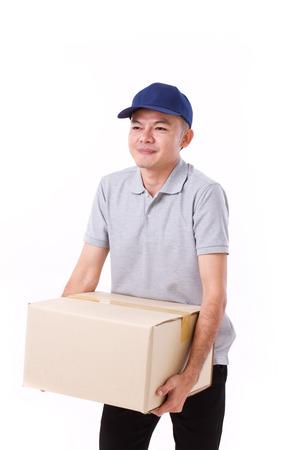 carrying heavy: unhappy man carrying heavy carton box or cardboard box