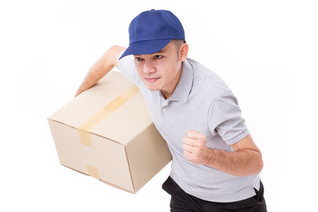speedy: male delivery staff running, hand holding parcel or box for speedy service Stock Photo