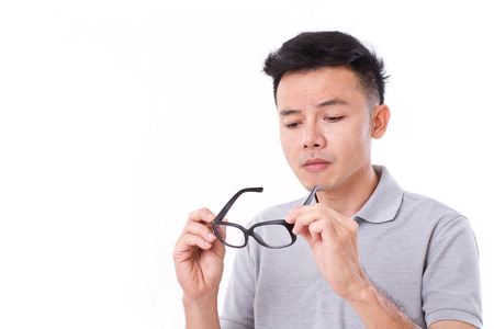 myopia: man suffers from short-sightedness, myopia or others eye disorder