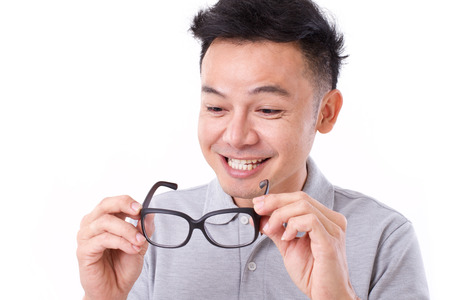 happy man with improved vision with eyeglasses photo