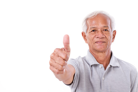 senior man giving thumb up photo