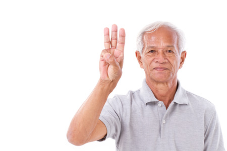 fingers: old man raising 3 fingers Stock Photo