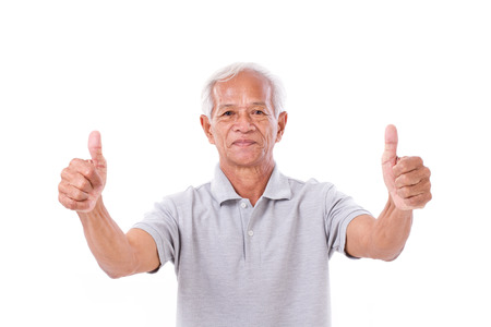 two thumbs up: senior man giving two thumbs up Stock Photo