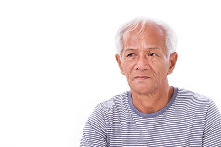 poor eyesight: old senior man suffering from eye disease, surfers eye, pterygium, poor eyesight Stock Photo