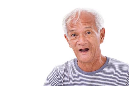 distressful: portrait of old senior man with eye sickness, surfers eye, pterygium, poor eyesight Stock Photo