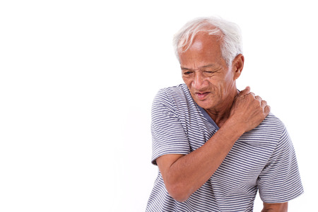 muscle injury: old man suffering from shoulder muscle inflammation or injury