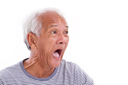 distressful: shocked, stunned, unhappy old man with surfer's eye or pterygium