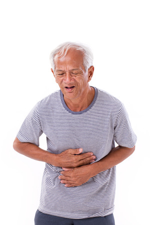 sick old man suffering from diarrhea, indigestive problem photo