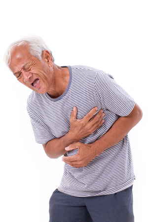 senior pain: sick old man suffering from heart attack or breathing difficulties Stock Photo