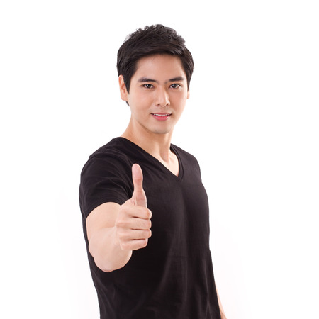 confident man giving thumb up gesture photo
