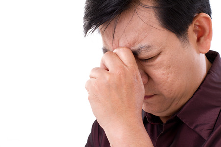 unhealthy thoughts: middle age man suffering from headache Stock Photo