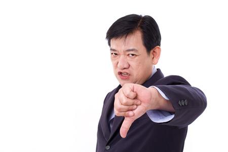 thumb down: angry, upset, serious businessman giving thumb down