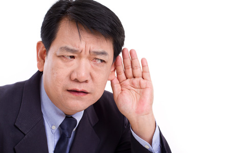negative spaces: middle aged business executive manager listening to bad news