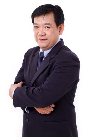 asian businessman: senior business executive crossing arms Stock Photo