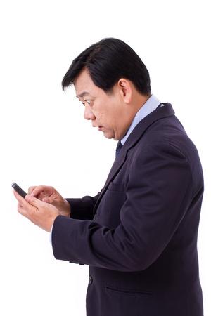 stunned, shocked senior businessman receiving bad news via smartphone application photo