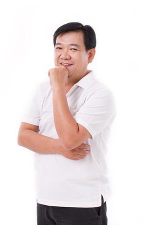 edad media: feliz, medio sonriente hombre de mediana pensamiento Foto de archivo