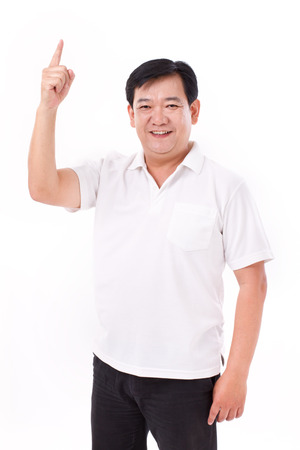 middle aged asian man pointing up to blank space Stock Photo